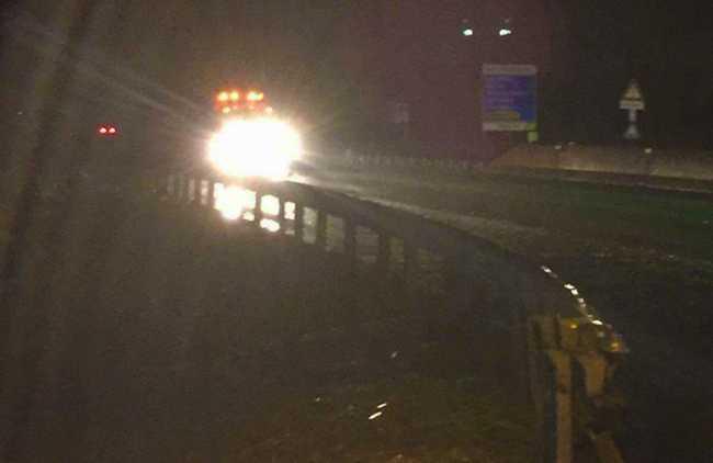 lavori superstrada notte pioggia luci